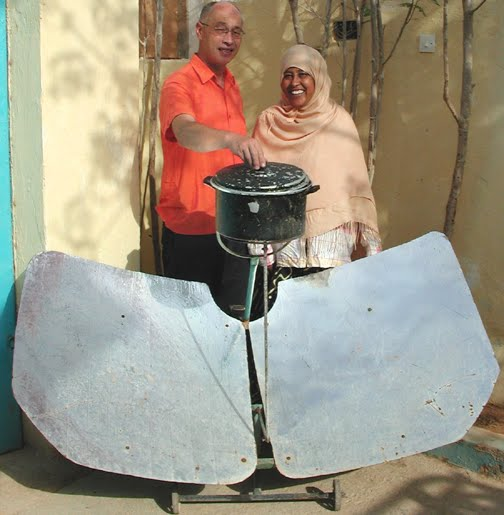 Fatima Jibrell with a solar cooker